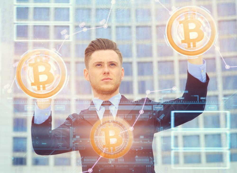 man controlling bitcoins